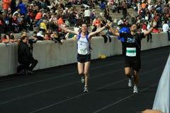 27th Athens Classic Marathon Moments. Anonymous marathon runners reaching the finish line Stock Photos