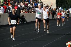 27th Athens Classic Marathon Moments. Anonymous marathon runners approaching the finish line Stock Photos