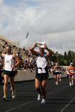 27th Athens Classic Marathon Moments. Anonymous marathon runner approaching the finish line Stock Image