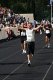 27th Athens Classic Marathon Moments. Anonymous marathon runner approaching the finish line Royalty Free Stock Photo