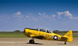 28577 - N. American AT-6 Harvard. Vintage war plane - North American AT-6 Harvard, taxiing on the slipway at Swartkop airbase, South Africa. (ZU-SAF Stock Photo