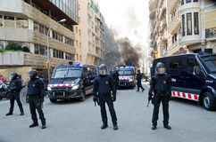29M - Barcelona burning. Spanish unions call for nation wide general strike against the new conservative Government´s labour reforms. Mossos d´Esquadra close Stock Photo