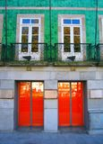 2x2 - Windows vs. Doors. A house in Braga with a store underneath it. The simmetry of doors, windows and colors Royalty Free Stock Images