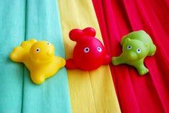 3个五颜六色的橡胶玩具 免版税库存图片