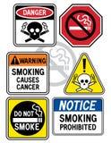3个危险等级符号抽烟 免版税库存图片