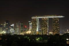 3个城市晚上新加坡地平线 免版税库存照片