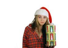 3个女孩辅助工s青少年的圣诞老人 免版税库存图片