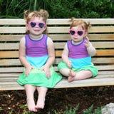 3个婴孩礼服女孩晒黑太阳镜二 免版税图库摄影