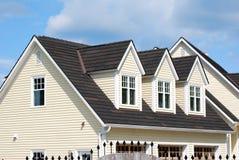 3个屋顶窗房子 免版税库存照片