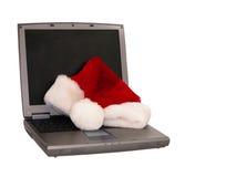 3个帽子膝上型计算机圣诞老人开会 免版税库存照片