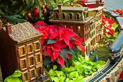 3个森林一品红玩具村庄 免版税库存图片