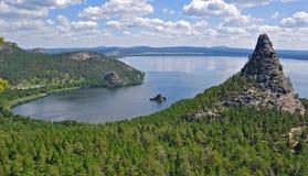 3个森林卡扎克斯坦湖北部岩石 免版税库存图片