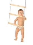 3个男孩梯子绳索 库存照片