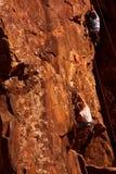 3个登山人岩石 库存照片