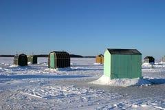 3个钓鱼的小屋冰 图库摄影