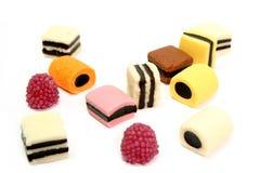 3个颜色表单果子滚多种甜点 免版税库存图片