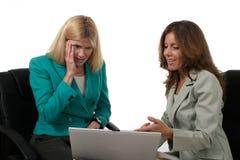 3名企业膝上型计算机二妇女工作 图库摄影