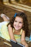 3愉快的女孩一点微笑 免版税库存照片