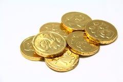3枚硬币好时运金子 免版税库存图片