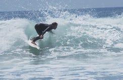 3现出轮廓的冲浪者 免版税库存图片