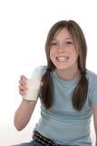 3饮用的女孩少许牛奶 库存照片