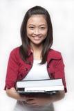 3 ασιατικά βιβλία που κρατούν το σπουδαστή Στοκ φωτογραφία με δικαίωμα ελεύθερης χρήσης