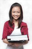 3 азиатских книги держа студента Стоковое фото RF