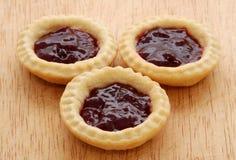 3 вкусных пирога варенья на деревянной таблице Стоковое Изображение RF