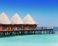 3 деревянных дома против океана Стоковые Фото