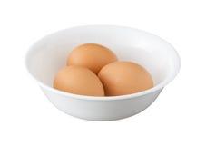 3 коричневых яичка в шаре изолированном на белой предпосылке Стоковое Изображение