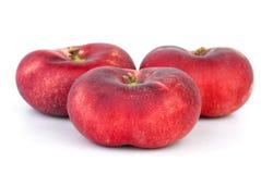 3 красных плоских персика Стоковое Фото