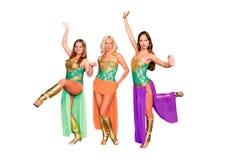 3 молодых красивейших женщины в платьях Стоковые Изображения RF