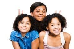 друзья представляя 3 Стоковая Фотография RF