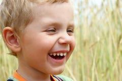 3 años de la risa del muchacho Fotografía de archivo