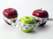 3 Apples Circled With Measuring Tape Royalty Free Stock Photography
