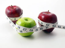 3 Apples Surrounded With Measuring Tape Royalty Free Stock Photo
