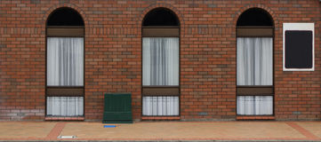 3 Arch Windows. Three modern arch windows in a brick wall Royalty Free Stock Images
