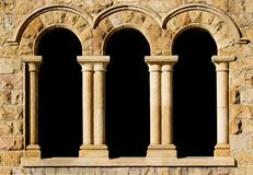 3 arches in sandstone. Old stone arches with pillars in an old building style with copy space Stock Images