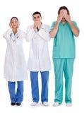 3 artsen zien niet, spreken niet en horen niet Stock Foto's