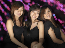 3 Asian Girls having a Party. Picture of 3 asian girls having an evening out and party Royalty Free Stock Photo