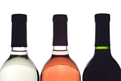 3 backlit wine bottles Royalty Free Stock Photo