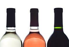 3 backlit wine bottles. Isolated royalty free stock photo