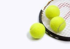 3 ballen en een racket Stock Fotografie