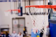 3 Basketball Hoops with nets hanging inside a gym Royalty Free Stock Images