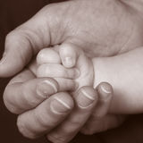 3 behandla som ett barn handen Arkivfoton