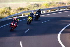 3 Bikers on curved road. Three bikers ride into El Puerto de Santa Maria from Jerez. Thousands of Bikers come to the moto GP in Jerez de la Frontera, Spain every royalty free stock images
