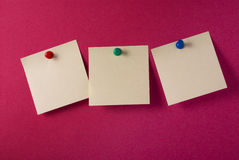 3 blank yellow adhesive notes on red. 3 yellow adhesive notes pinned on a red notice board. See others like this Royalty Free Stock Photography
