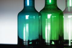 3 botellas de cristal azulverdes y claras Foto de archivo libre de regalías