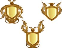 3 Bronze decorated  emblems or  crests Royalty Free Stock Images