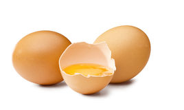 3 brown egg's. On withe background one open Royalty Free Stock Photography